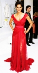 Halle Berry in a raspberry lace Elie Saab Couture gown at the 2011 Costume Designer Awards