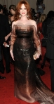 Christina Hendricks in an ombre bronze Carolina Herrera off the shoulder gown