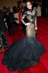Christina Ricci in a black tulle webbed Zac Posen train gown