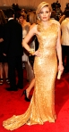 Elizabeth Banks in a gold sequined Tommy Hilfiger one-shoulder gown