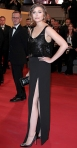 Elizabeth Olsen in a black sequined gown by The Row with black sating pointed toe pumps & an embellished headband