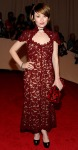 Emily Browning in a burgundy brocade Marc Jacobs dress with Stephen Russell jewelry & Sergio Rossi pumps