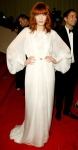 Florence Welch in a white sheer Yves Saint Laurent organza & feathers dress
