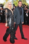 Gwen Stefani in a sequined black Stella McCartney jumpsuit with a Roger Vivier clutch & Gavin Rossdale