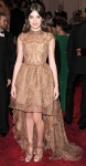 Hailee Steinfeld in a tan lace Stella McCartney mullet dress with Nicholas Kirkwood heels