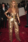 Iman in a gold sequined Stella McCartney jumpsuit