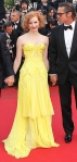 Jessica Chastain in a yellow sweetheart Zac Posen gown with jewelry by Louis Vuitton