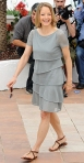 Jodie Foster in a gray tiered dress with brown sandals