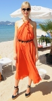 Karolina Kurkova in an orange Vionnet dres with Giorgio Armani sunglasses & Charlotte Olympia heels