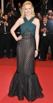 Kirsten Dunst in a halter polka dot Rodarte gown with an emerald cuff bracelet
