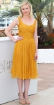 Kirsten Dunst in a mustard Chloe dress with strappy Jimmy Choo heels