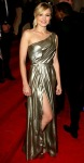 Kristen Bell in a Grecian one-shoulder gold Tory Burch dress with Amrapali chandelier earrings
