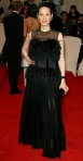 Lucy Liu in a feather & sheer Vionnet gown with Lorraine Schwartz jewelry & Sergio Rossi pumps