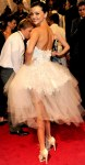Miranda Kerr in a white strapless flared Marchesa tulle dress with Harry Winston jewelry