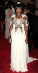 Naomi Campbell in a white crystal embroidered Alexander McQueen gown