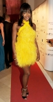 Naomi Campbell in a yellow feathered Versace mini dress