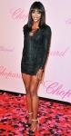 Naomi Campbell sin a laceup Emilio Pucci mini with two-tone Sergio Rossi heels