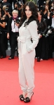 Paz Vega in a beige satin jumpsuit by Azzaro with Roger Vivier heels & Chopard jewels
