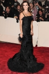 Penelope Cruz in a black tulle tiered Oscar de la Renta gown with a Roger Vivier clutch & Chopard diamonds