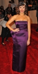 Rashida Jones in a deep purple Stella McCartney peplum gown