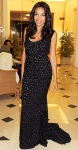 Rosario Dawson in a black patterend gown