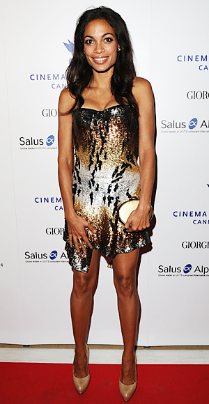 Rosario Dawson in a sequined mini with nude heels & an oval clutch