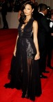 Thandie Newton in a black lace trimmed halter Stella McCartner gown