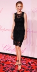 Uma Thurman in a black lace Dolce & Gabbana dress with Giuseppe Zanotti sandals