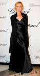Uma Thurman in a black satin gown with a black flyaway evening jacket