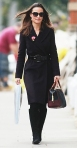 Pippa Middleton in a black trench coat with a leather belt & top handle bag with knee-high black leather boots