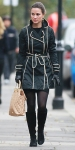 Pippa Middleton in a Fay black coat with beige piping, Russell & Bromley boots, Vinnie Day heart earrings, & a Lamb 1987 beige tote bag