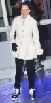 Pippa Middleton in a white coat with black pants & gloves