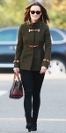 Pippa Middleton in an army green Fay funnel neck coat with leather clasps, leggings, & a Loewe bowling bag