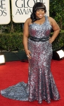 Amber Riley in a shimmering gunmetal one-shoulder gown by Oliver Tolentino