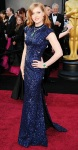 Amy Adams in a midnight L'Wren Scott gown with emerald Cartier jewelry