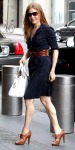Amy Adams in a navy Tory Burch shirtdress with a Cartier handbag & leather lace-up shooties