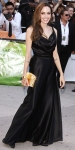Angelina Jolie in a satin Vivienne Westwood gown with a gold Louis Vuitton clutch & Stuart Weitzman pumps