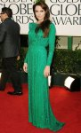 Angelina Jolie in a shimmering green Versace gown with Ferragamo heels