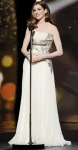 Anne Hathaway in a cream embellished Givenchy gown