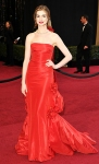 Anne Hathaway in a red vintage Valentino bustle gown