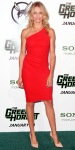 Cameron Diaz in a poppy one-shoulder Azzaro dress with C. Greene gold hoops, & Casadei pointy toe heels