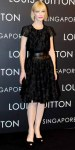 Cate Blanchett in a black belted textured Louis Vuitton dress