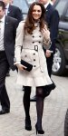 Catherine Middleton in a Burberry trench coat with black heels & a clutch