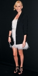 Charlize Theron in a feather Dior dress with a black blazer