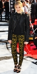 Chloe Grace Moretz in a pair of Stella McCartney lace leggings with a black top & motorcycle jackets
