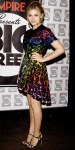 Chloe Grace Moretz in a rainbow look by Christopher Kane with strappy sandals