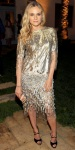 Diane Kruger in a gold Prabal Gurung dess with a Ferragamo clutch
