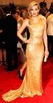 Elizabeth Banks in a gold one-shoulder Tommy Hilfiger gown
