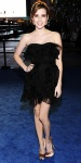 Emma Roberts in a black Christian Dior ruffle dress with gold satin pumps