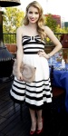 Emma Roberts in a black & white Kate Spade dress with jewelry by Swarovski